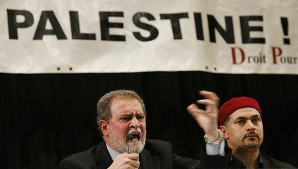 """Tamimi gestures during a conference on the """"60 years of the Nakba in Geneva"""