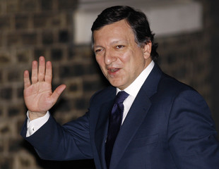 European Commission President Jose Manuel Barroso smiles as he arrives for a meeting at Downing Street in London