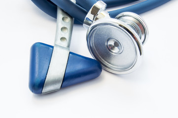 Blue stethoscope and neurological hammer closeup on white background as medical tool for preparation or conduct physical examination of patient by physician for presence of diseases and pathologies