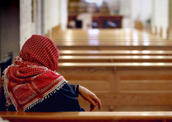 PALESTINIAN ATTENDS MASS IN THE CHURCH OF THE NATIVITY IN BETHLEHEM.