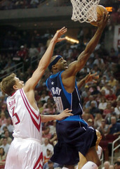 Mavericks Terry puts up shot against Rockets Sura during fist half of Game Four in Houston.