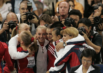 US team celebrates after winning the women's team final at the 40th World Artistic Gymnastics Championships in Stuttgart