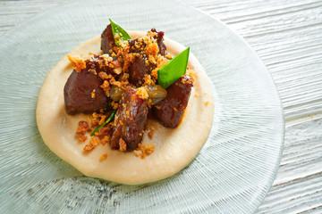iberico pig cheeks pork meat with mangetout sugar snap peas