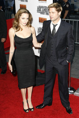 """Actors Brad Pitt and Angelina Jolie arrive for the premiere of the film """"The Assassination of Jesse James By The Coward Robert Ford' in New York"""
