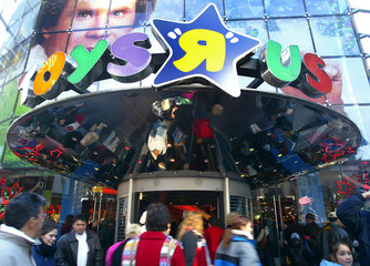 Shoppers go inside and out of Toy R Us in New York.