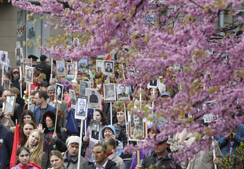 People carry pictures of World War Two soldiers as they take part in Immortal Regiment march during Victory Day celebrations, marking 72nd anniversary of victory over Nazi Germany in World War Two, in Stavropol