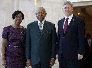 Manning accompanied by first lady welcomes Canadian Prime Minister Harper at the National Academy in Port-Of-Spain