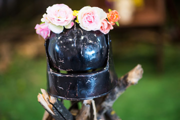 Iron helmet of the medieval knight. Very heavy headdress with flowers