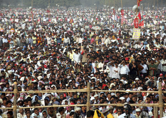 Communist Party activists listen to speech by Chief Minister of communist-ruled West Bengal Bhattacharjee in Kolkata