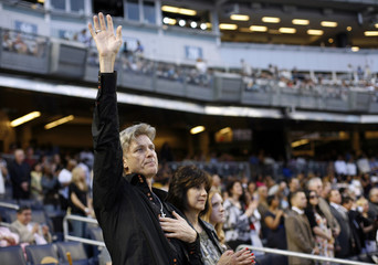 """A man raises his hand in prayer during the """"Historic Night of Hope"""" by the evangelist Joel Osteen ministries at Yankee Stadium in New York"""