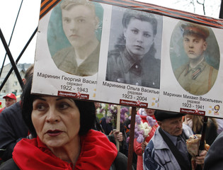 Woman holds pictures of World War Two soldiers as they take part in Immortal Regiment march during Victory Day celebrations, marking 72nd anniversary of victory over Nazi Germany in World War Two, in Stavropol