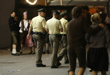 German police officers monitor festival goers at Munich's Oktoberfest