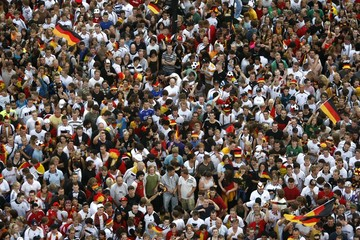 Soccer fans await the screening of the Euro 2008 semi-final maatch at the 'Fanmile' public viewing area in Berlin