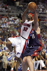 Detroit's Hamilton goes up for a shot as he is fouled by Cleveland Ilgauskas during Game 5 of the NBA's Eastern Conference basketball series in Auburn Hills, Michigan