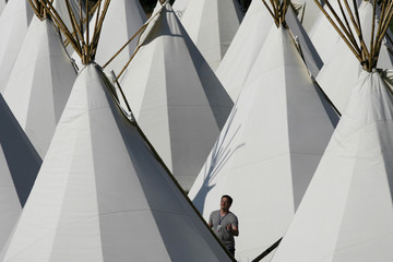 A man looks at one of the tipi tents at the Glastonbury Festival 2009 in south west England