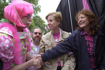 Actress Sarandon greets doctor/activist Adams backstage during Mother's Day Peace Protest near White House in Washington