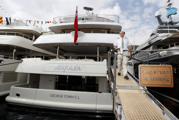 A captain leaves his boat during the 18th Monaco Yacht Show in Monaco