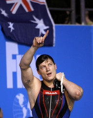 Lisogor of Ukraine gestures after winning the men's 50m breaststroke swimming final in Melbourne