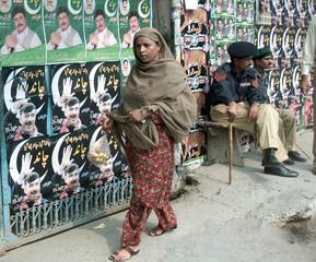 PAKISTANI WOMAN WALKS PAST POLLING STATION AFTER CASTING VOTE INRAWALPINDI.