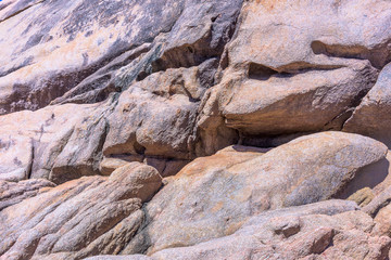 Weathered pink granite rocks and boulders