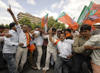 Activists from the Bharatiya Janata Yuva Morcha shout anti-government slogans during a protest against the hike in fuel prices in Hyderabad
