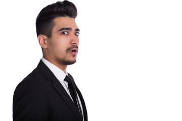 Close up of shocked man in black suit isolated on white background.