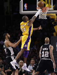 Lakers Bryant scores between Spurs Duncan and Bowen during Game 1 of their NBA Western Conference final basketball playoff series in Los Angeles