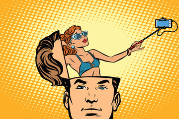 Man with an open head selfie girl, smartphone