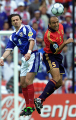 ABELARDO OF SPAIN JUMPS TO HEAD BALL WITH PREDRAG MIJATOVIC OF YUGOSLAVIA AT EUROPEAN CHAMPIONSHIP MATCH.