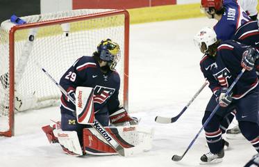 Russian Enver Lisin scores on United States goaltender Al Montoya.