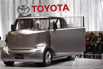 Visitors look at Toyota Motor Corp's Hi-CT concept vehicle, an urban truck inspired by the silhouette of a gorilla, during the 40th Tokyo Motor Show