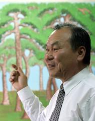 South Korean painter Lim Ki-man explains how his pine tree pictures tempt sparrows in his studio in ..