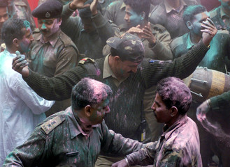 SOLDIERS DAUBED IN COLOURED POWDER DANCE DURING HOLI FESTIVAL INSRINAGAR.