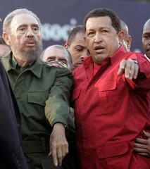 Cuba's President Castro and Venezuela's President Chavez attend a rally in Cordoba