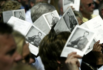 Guests at the opening of the Lincoln Presidential Library and Museum in Springfield, Illinois, use p..
