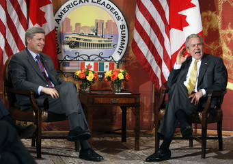 U.S. President Bush reacts during a bilateral meeting with Canada's PM Harper at the North American Leaders' Summit in New Orleans