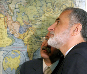 Iranian Foreign Minister Kharrazi looks at an old Arab published map of the Middle East during a map ...