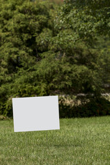 Blank white yard sign with a shallow depth of field