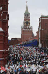 People carry pictures of World War Two soldiers as they take part in Immortal Regiment march during tVictory Day celebrations, marking 72nd anniversary of victory over Nazi Germany in World War Two, at Red Square in Moscow