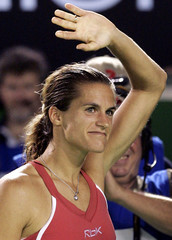 Mauresmo of France waves to crowd after Clijsters of Belgium retired from their match due to ankle injury at Australian Open in Melbourne