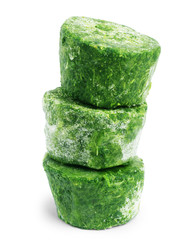 block of frozen chopped spinach on a white background.