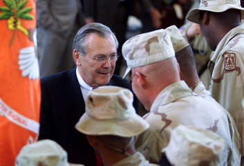 DONALD RUMSFELD SPEAKS TO SOLDEIRS AT THE BAGRAM AIR BASE.