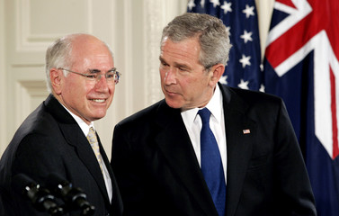 John Howard and President Bush talk to reporters at the White House