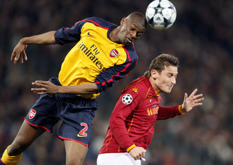 Arsenal's Diaby and AS Roma's Totti jump for the ball during their Champions League soccer match in Rome