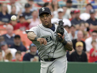 Mariners third baseman Beltre throws out Nationals batter Spivey during inter-league game in Washington.