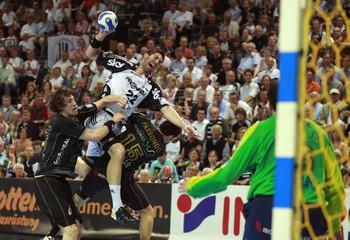 Karabatic of THW Kiel attempts to score past goalkeeper Sterbik of Spain's Ciudad Real during their Handball Champions League final match in Kiel