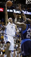 Denver Nuggets' Martin throws up a shot over Dallas Mavericks' Dampier during Game 2 in Denver