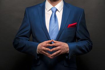 Man gentleman in black suit and tie