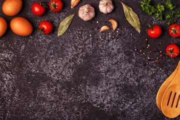 Ingredients for cooking on dark concrete background.