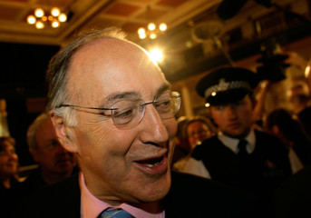 Conservative Party Leader Howard leaves the Folkestone civic hall south-east England.